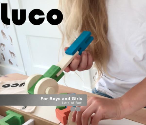 Girl holding Luco Large For smart children Eco wooden Blocks Lucotoys